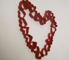 Heart Paper Craft - no link but I can get it from the picture.  Bet you make it out of toilet paper rolls...better save more.  ;)