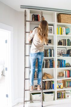 Billy Bookcase Hack with Library Ladder Recreating Belle's library with barndoor hardware, antique ladder, and Ikea Billy Bookcase Hack More from my siteIKEA HEMNES BUILT-IN HACK! Ikea Billy Bookcase Hack, Bookcase Wall, Bookshelves, Billy Bookcases, Bookshelf Ladder, Billy Bookcase With Doors, Bookshelf Design, Wall Shelves, Library Ladder
