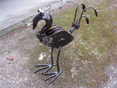 """Pully Bird"" Garden Art ""Pully Bird"" garden sculpture made from recycled metal objects. 42 cm high x 39 cm in length. Metal Yard Art, Metal Tree Wall Art, Scrap Metal Art, Welding Art Projects, Metal Art Projects, Welding Ideas, Metal Art Sculpture, Garden Sculpture, Metal Birds"