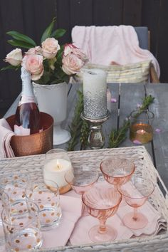 Try decorating your table in a soft, feminine style. Choose a pale palate of blush with metallics for a little sparkle. HomeGoods, Sponsored Pin.