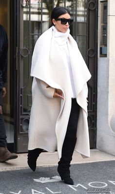 Kim and Kanye leaving Hôtel Le Royal Monceau in Paris, France Love her coat!