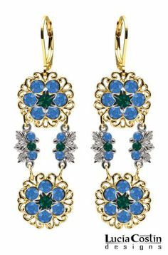 Enchanting Dangle Earrings by Lucia Costin Crafted in 14K Yellow Gold over .925 Sterling Silver with Green, Blue Swarovski Crystal Flowers Surrounded by Filigree Elements and Leaf Details; Handmade in USA Lucia Costin. $87.00. Dangle ornaments accented with floral design. Amazingly studded with emerald - green and sapphire Swarovski crystals. Mesmerizing enough to wear on special occasions, but durable enough to be worn daily. Floral earrings amazingly designed by Lucia Costin. ...