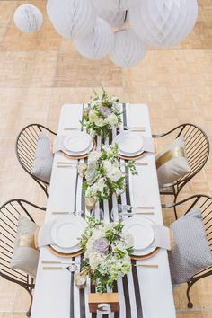 Stripe added to white tablecloth is a great background for something stunning down the middle