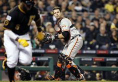 Buster Posey #28 of the San Francisco Giants throws out Josh Harrison #5 of the Pittsburgh Pirates in the third inning during the National League wild-card game at PNC Park on Oct. 1, 2014 in Pittsburgh, Pennsylvania. (Justin K. Aller/Getty Images)