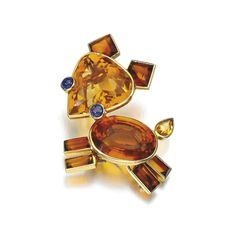Citrine and sapphire brooch, Cartier, 1940s Designed as a stylised dog, set…