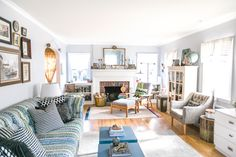 The living room furniture layout was a challenge for the couple, since the room is so long and narrow. The cozy corner near the fireplace is a favorite reading nook of Alex's.