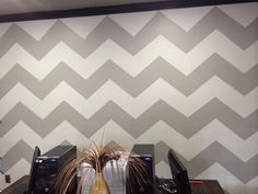A traditional chevron that can turn any open space into something that's luxurious, unique and quite eye catching.   Base coat: agreeable Grey  Second layer: Fundamental gray