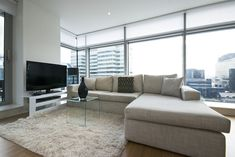 Contemporary living room with designer furniture, floor to ceiling windows and panoramatic views - stock photo Engineered Hardwood Flooring, Hardwood Floors, Cabinets And Countertops, Floor To Ceiling Windows, Open Plan Living, Interior Design Inspiration, Living Room Designs, Living Room Furniture, Furniture Design