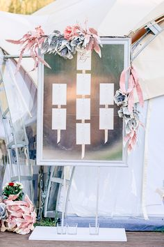 ribbon seating charts - photo by Konstantin Semenikhin http://ruffledblog.com/magical-russian-wedding-with-eye-catching-displays