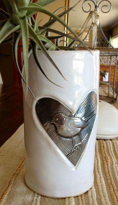 Pewter heart on pottery vase