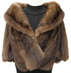 Sable Stole; #SS531; $1275; Very Good Condition; Size range: S - M - L. This is a gorgeous genuine natural sable stole. It has an Alaskan Custom Built Furs label and features a gorgeous large portrait collar with silk on the underside. There are openings on each side to rest your hands. It has a dark brown silk lining and there is an initial monogram in the same color as the lining so it is discreet. There is one hook and eye closure. You will love this stunning sable fur stole!