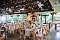 Rustic and romantic farm tables farm tables (for rent from Buttercup) create a fairy-tale setting for Sarah and Jason's Audubon wedding: Littlewing Studios Photography.