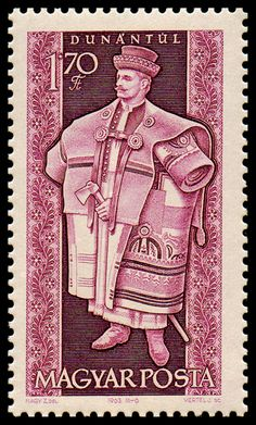 Szűr: the long embroidered felt cloak of Hungarian shepherds. Dunántúl (Transdanubia)  is a traditional region of Hungary. Postage stamp from Hungary, 1963