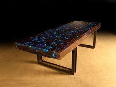 World Bazaar Outlet - 10 ft L dining Table desk Driftwood Resin Embedded LED lights iron Rail Base, $27,000.00 (http://www.worldbazaaroutlet.com/10-ft-l-dining-table-desk-driftwood-resin-embedded-led-lights-iron-rail-base/)