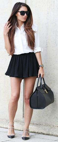 Monochrome has never looked better than on Lydia Millen, with her black skirt and matching bag with a white shirt!  Shops: not specified