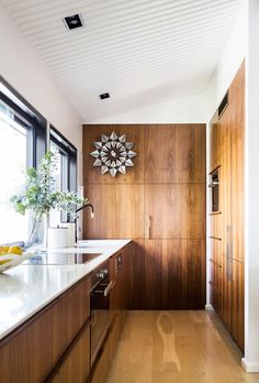 Timber kitchen from a beautifully restored modernist home on the Gold Coast. Photo: Maree Homer | Styling: Kate Nixon