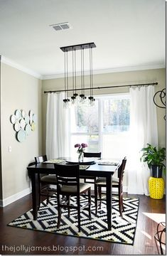We're obsessed with this modern dining room. The plates on the wall are from HomeGoods as well as the yellow garden stool!