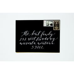 White ink on black envelope by Cast Calligraphy