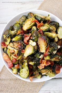 Roasted Brussels Sprouts with Bacon & Almonds - The perfect side dish for any meal! Simple recipe and unbelievably delicious!