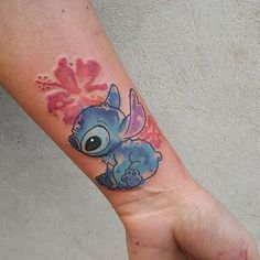 Super pretty Stitch watercolor piece done by @michelabottin #inkeddisney