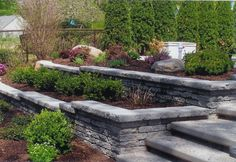 Tiers ... the whole purpose to retaining wall is I want to landscape the hill and use the whole back yard for outdoor entertaining as well.
