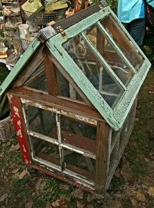 little greenhouse made of reclaimed painted windows