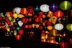 Multicoloured lights: Rainbow-coloured lanterns of all shapes and size bring Hoi An alive dark