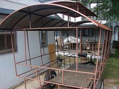 love the roof pop up and that it's framed in metal...good thing I'm married to a welder...