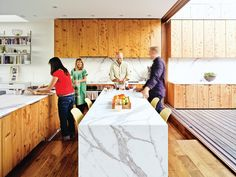 Kitchen, Medium Hardwood Floor, Marble Counter, Wood Cabinet, Marble Backsplashe, Recessed Lighting, Wall Oven, Range, and Drop In Sink The kitchen is beautifully textured and veined thanks to white Carrara marble countertops installed by New Marble Company and reclaimed cypress cabinets built by Wayne Berger.  Photo 235 of 2171 in Best Kitchen Photos from Striking Slatted Wood and Glass Home in San Francisco
