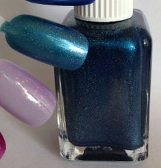IName: Sample GGM #15 Description: medium navy blue with green shimmer and light holographic