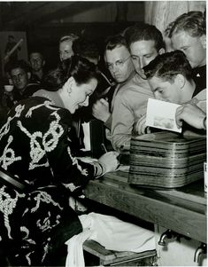 Historic Photograph of Hedy Lamar Signing Autographs At The Hollywood Canteen