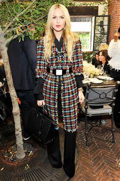 Rachel Zoe in a long tweed belted Chanel coat over black flare leg pants