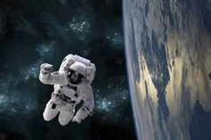 An Astronaut Floating Above Earth Photographic Print
