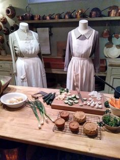 The set shows Mrs. Patmore's kitchen, with the uniforms worn by Daisy and Mrs. Patmore on Downton Abbey Downton Abbey, Daisy, Kitchen, Cuisine, Daisy Flowers, Daisies, Home Kitchens, Kitchens, Bellis Perennis