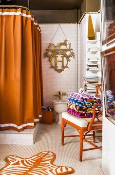 Jonathan Adler's bathroom. Via Lonny Magazine. The orange curtain and accessories are yummy.