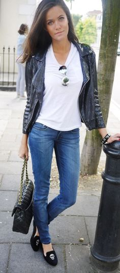 White tee, Ray Bans, jeans, and flats.
