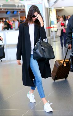 We love Kendall Jenner's simple outfit for heading to the airport! Check out www.travelfashiongirl.com for more suggestions on traveling in style.