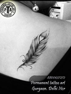 feather tattoo design, tattoo design with black shading , amazing feather tattoo , beautiful feather tattoo,  design for girls,  tattoo on back, feather tattoo design with heart Done by -Deepak Karla 8800637272 AT- Permanent tattoo art, Gurgaon