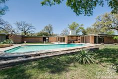 This stunning 1955 midcentury modern house in Fort Worth is a study in sculptured textured surfaces: Ceramic block, glass block, iron walls, terrazzo floors and more.