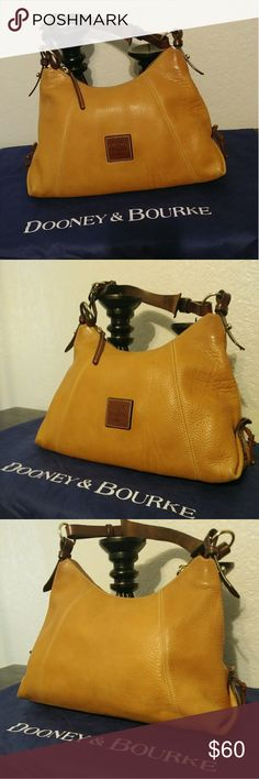 """Dooney and Bourke Brown Hobo Shoulder Bag Caramel colored Dooney & Bourke Hobo shoulder bag.  Measures: 16""""L x 10""""T x 4""""W with 11"""" drop but has expandable shoulder strap to make drop longer or shorter. Leather has stretch marks, corner wear & what appears to be surface dirt outside (as pictured). Inside also has marks (as pictured). Dooney & Bourke Bags"""