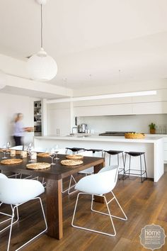 Or just black stools. Classic black and white stools work well in this functional and streamlined kitchen.