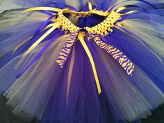 Purple and Gold Extremely Full Tutu with Tiger ribbon trim  Available in all sizes. Add $20.00 for sizes 8-14. Call or email for adult pricing.