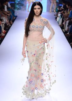 Model walks the ramp in cream floral embroidered saree for Arpita ...