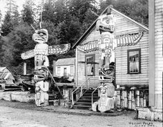 Alert Bay. A mix of the old with the new... Old totems. Newer frame houses with glass windows.