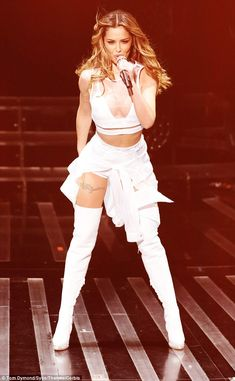 White hot! Cheryl  Fernandez-Versini took to the stage in a sizzling white outfit consisting of a plunging cropped top, thigh-high boots and a pair of hotpants
