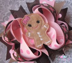 Gingerbread Girl Pink and Brown Hair Bow. $10.99, via Etsy.  Is it too early to think about a  holiday birthday party?