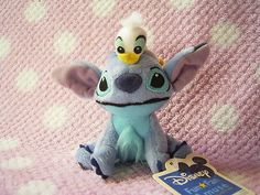 "Disney LiLo & Stitch Kawaii Small Plush Stuffed Doll w/ Tiny Donald Duck SALE! : *condition* Unused, HOWEVER this item is kinda old and the paper tag has changed color due to age, so please make sure to check all of the pictures in the picture's gallery before bidding or purchasing! Released (Licensed) by Disney x SEGA Japan in 2006 *Size >> About 4.3"" (11cm) in height.* 20.14-29.99 (4.90/5.50/7.50)"