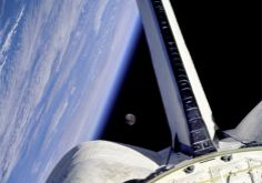 Earth, Moon and space shuttle