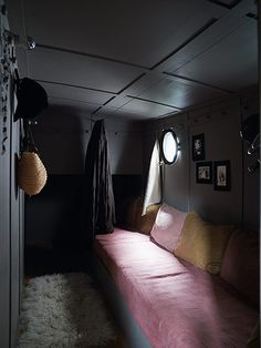 Credit: Richard Powers The bedrooms are painted dark grey, with moody shafts of light from portholes. Margot's room has a sheepskin rug and ...