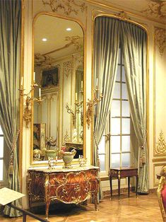 I have silk fabric the color of these drapes that I will use for Mozart's salon/apt. I want Salieri's and the Emperor's salons to be more of a mix of Rococo and Baroque and Mozart's the lighter, airier Rococo. DMW